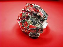 Jewelry ring with red ruby crystals Royalty Free Stock Image