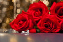 Jewelry ring and roses Stock Photos