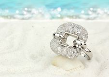 Jewelry ring on sand beach as background with copy space royalty free stock images