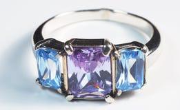 Jewelry ring with three precious stone. Horizontal stock photos