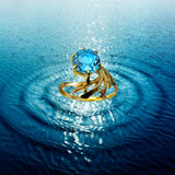 Jewelry ring in water waves royalty free stock photography