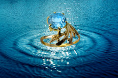 Jewelry ring in water waves royalty free stock photos