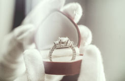 Jewelry ring. White-gloved hands show jewelry ring Royalty Free Stock Image