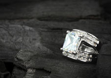 Jewelry ring witht big brilliant on dark coal background Royalty Free Stock Photo