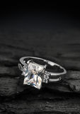 Jewelry ring witht big diamond on dark coal background Stock Images