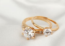 Jewelry rings with diamond on white cloth, soft focus. Jewelry rings with diamond on white cloth Stock Image