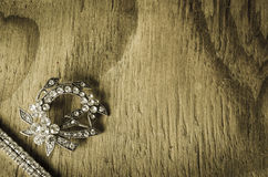 Jewelry on Rustic Wood Royalty Free Stock Images