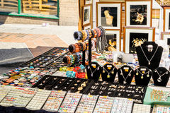 Jewelry for sale on sidewalk Royalty Free Stock Photography