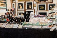 Jewelry for sale on sidewalk Stock Photos