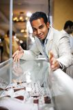 Jewelry seller. Indian businessman selling diamond jewelry stock image
