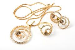 Jewelry set. Yellow gold set on white background Royalty Free Stock Photography