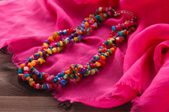 Jewelry set in oriental style necklace beads on pink silk shawl Stock Photos