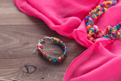 Jewelry set in oriental style necklace beads on pink silk shawl Stock Photo