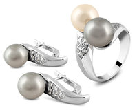Jewelry set on white. Jewelry set with pearl and diamonds on white Royalty Free Stock Images