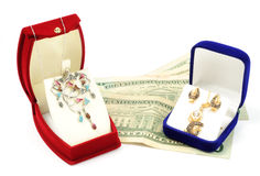 Jewelry sets. In boxes and dollars, on white background Stock Image