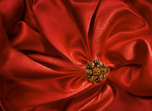 Jewelry Shape over Red Silk Cloth Background, Fabric folds. As Abstract Blank Backdrop Stock Images