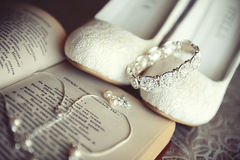 Jewelry and shoes with open book of Pushkin's poems. Wedding jewelry and shoes with open book of Pushkin's poems Royalty Free Stock Photography