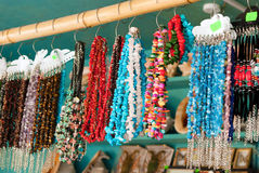 Jewelry in the shop. A variety of jewelry in the shop of souvenirs at the height of the summer season Stock Photos