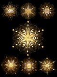 Jewelry snowflakes. Golden, glittering, jewelry snowflakes on a dark background royalty free illustration