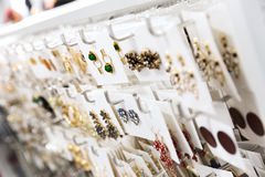 Jewelry store. Closeup of earrings stand royalty free stock photography