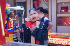 Jewelry store promotions, pig eight quit performances to attract people. In Xixiang, Shenzhen, china Royalty Free Stock Image