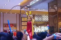 Jewelry store promotions, Sun Wukong performances to attract people. In Xixiang, Shenzhen, china Royalty Free Stock Image