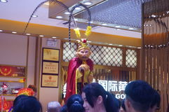 Jewelry store promotions, Sun Wukong performances to attract people. In Xixiang, Shenzhen, china Stock Photos