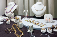 Jewelry at store window. Variety jewelry at store window stock images