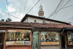 Jewelry Street In Novi Pazar, Serbia. NOVI PAZAR, SERBIA - JULY 25, 2017: showcases of shops specialise in gold jewellery under the minaret of Arap Mosque in stock photos