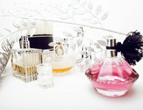 Jewelry table with lot of girl stuff on it, little mess in cosmetic brushes, women interior concept, perfume elegance Royalty Free Stock Images