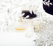 Jewelry table with lot of girl stuff on it, little mess in cosmetic brushes, women interior concept, perfume elegance Royalty Free Stock Photos