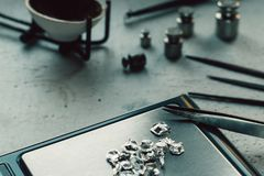 Jewelry tools. Jewellery. Goldsmith workplace, workspace on light background. Hand craft. Workshop. Manufacturing. Weigh Stock Images