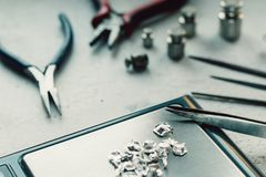 Jewelry tools. Jewellery. Goldsmith workplace, workspace on light background. Hand craft. Workshop. Manufacturing. Weigh Royalty Free Stock Photography