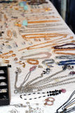 Jewelry and trinkets for sale at market Stock Photography