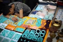 Jewelry vendor sleeping Stock Image