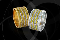 Jewelry wedding bands gold rings with diamonds 3D rendering. Jewellery wedding bands white and yellow gold rings with white and yellow round cut diamonds on Royalty Free Stock Image