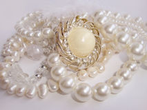 Jewelry, white pearl necklace and brooch Stock Photography