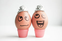 Jewelry and women. Funny eggs with painted Stock Photos