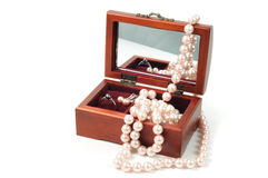 Jewelry wooden box. Wooden jewelry box with pearl jewel inside Stock Photo