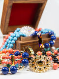 Jewelry in Wooden Box Stock Images
