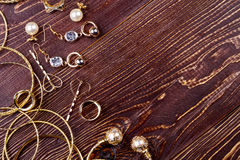 Jewelry on wooden surface. Stock Image
