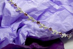 Jewels 1. Jewels on purple background Royalty Free Stock Images