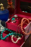 Jewels box with necklaces, earrings, bracelet, rings and perfume Royalty Free Stock Photography