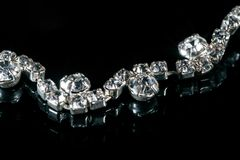 Jewels with diamonds on a black background.  Royalty Free Stock Photo