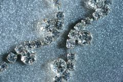 Jewels with diamonds close-up on a light background.  Royalty Free Stock Photos