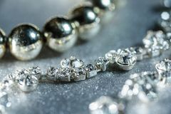 Jewels with diamonds close-up on a light background.  Stock Photography