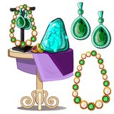 Jewels of emeralds and pearls. Presentation of jewels Royalty Free Stock Images