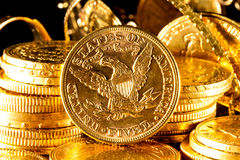 Jewels and gold coins. Over dark background royalty free stock photos
