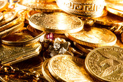 Jewels and gold coins. Over dark background royalty free stock photo