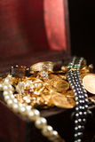Jewels and gold coins Stock Images
